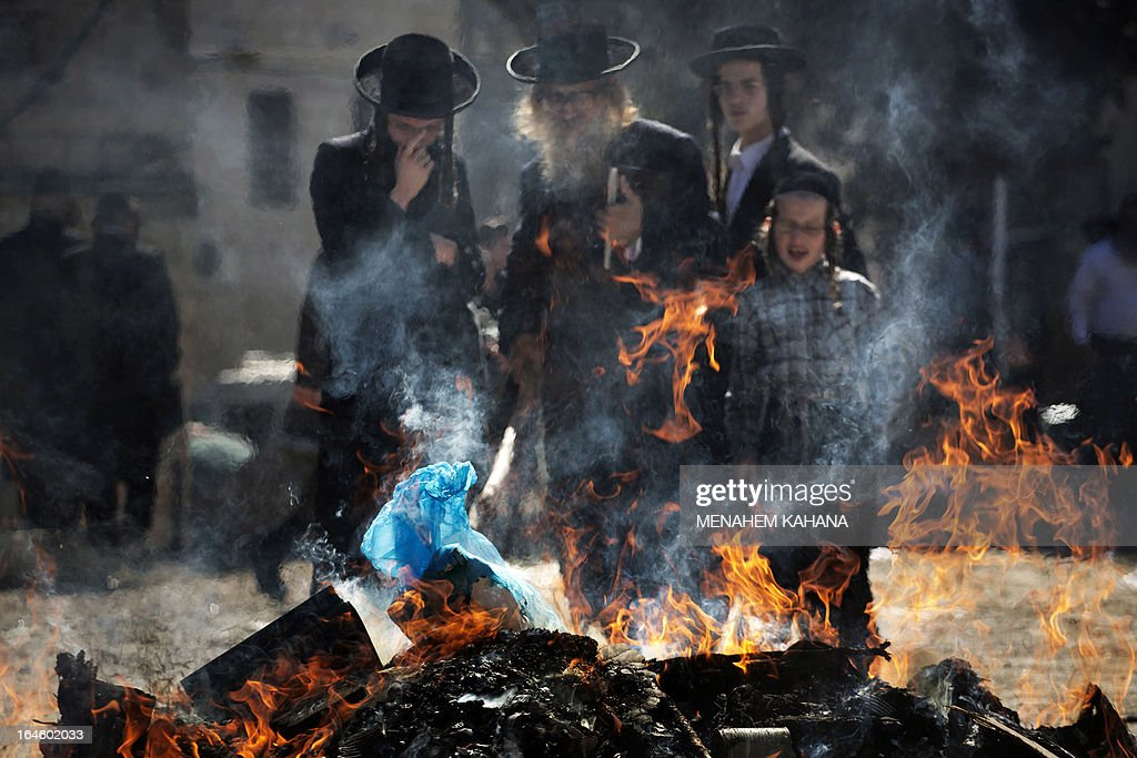 Ultra-Orthodox Jews burn leavened items in a final preparation before the start at sundown of the Jewish Pesach (Passover) holiday, on March 25, 2013 in Jerusalem. Religious Jews worldwide eat matzoth during the eight-day Pesach holiday that commemorates the Israelis' exodus from Egypt some 3,500 years ago and their ancestors' plight by refraining from eating leavened food products. AFP PHOTO/MENAHEM KAHANA