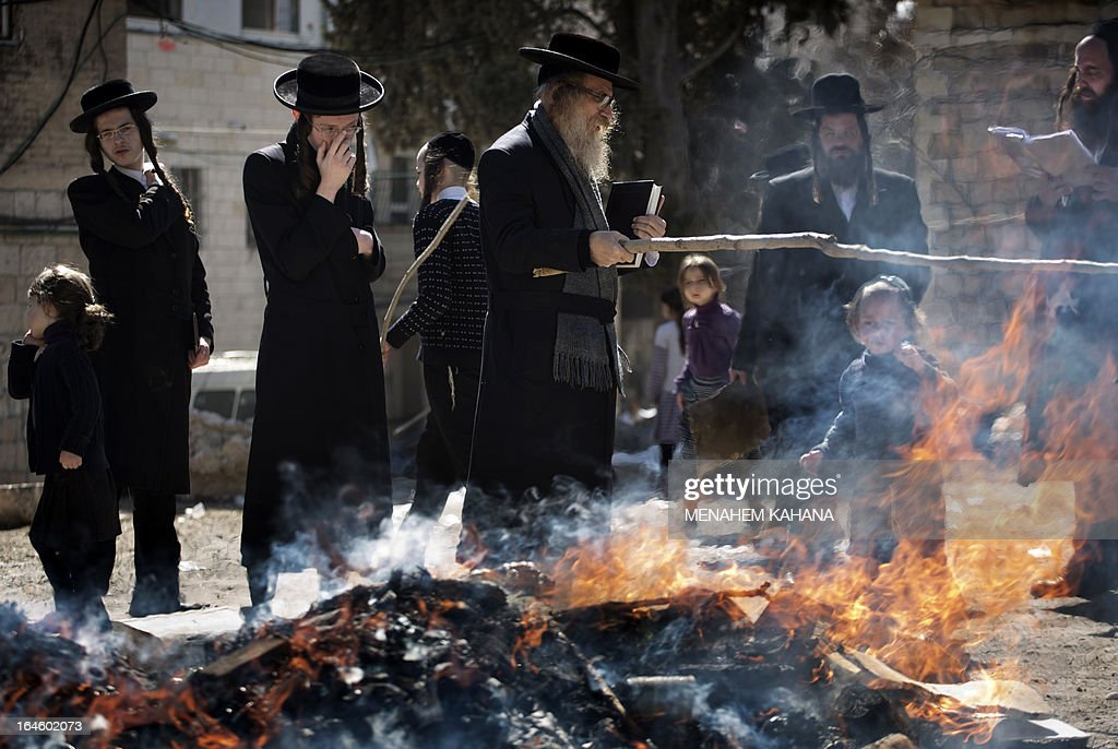 Ultra-Orthodox Jews burn leavened items in a final preparation before the start at sundown of the Jewish Pesach (Passover) holiday, on March 25, 2013 in Jerusalem. Religious Jews worldwide eat matzoth during the eight-day Pesach holiday that commemorates the Israelis' exodus from Egypt some 3,500 years ago and their ancestors' plight by refraining from eating leavened food products.