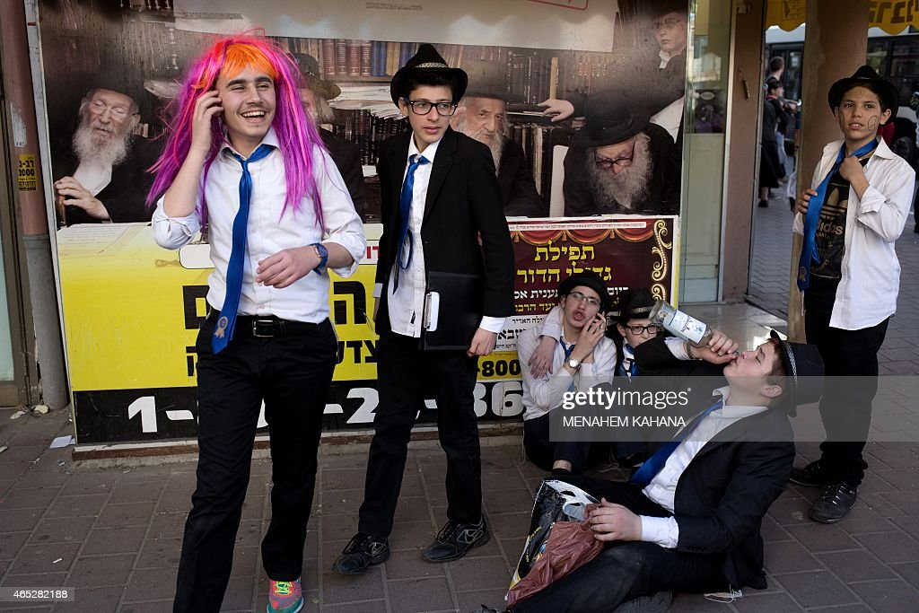 UltraOrthodox Jews celebrate and get drunk in the Israeli city of Bnei Brak near the coastal city of Tel Aviv on March 5 2015 during the feast of...