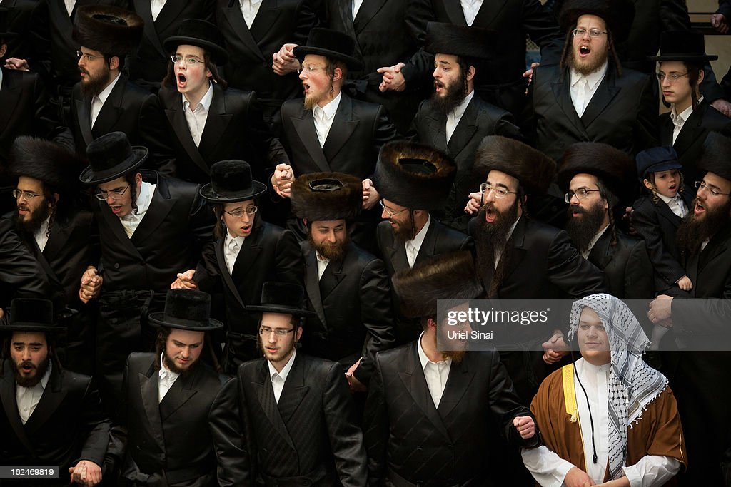 UltraOrthodox Jews celebrate Purim at a synagogue on February 23 2013 in Bnei Brak IsraelThe carnivallike Purim holiday is celebrated with parades...