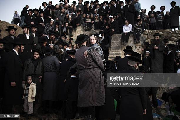 UltraOrthodox Jews collect water from a mountain spring near Jerusalem on March 24 2013 to be used in baking the unleavened bread known as matzoth...