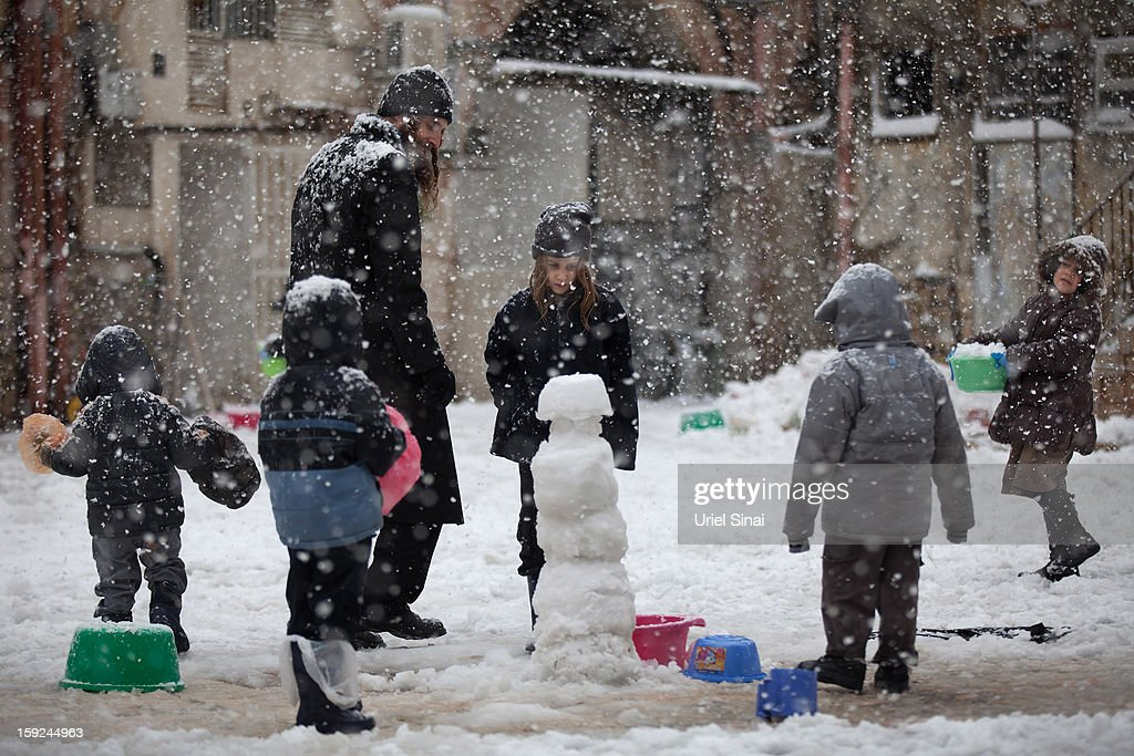 Ultra-orthodox Jews enjoy the snow in the Mea Shearim religious neighborhoodon January 10, 2013 in Jerusalem, Israel.
