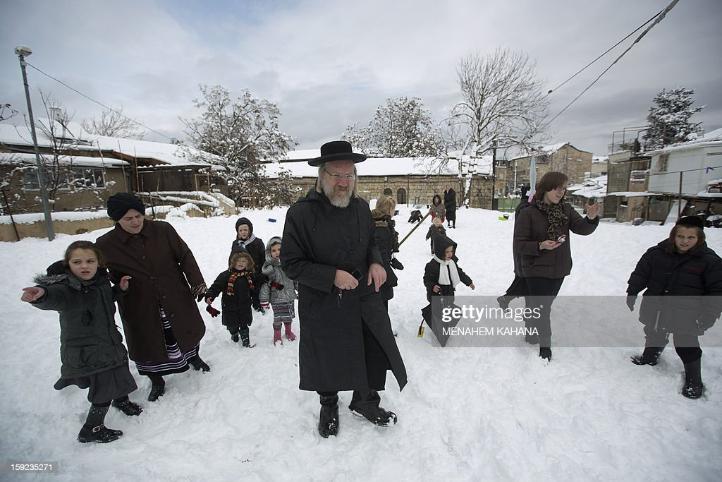 Ultra-orthodox Jews enjoy the snow in the Mea Shearim religious neighborhood of Jerusalem on January 10, 2013. Jerusalem was transformed into a winter wonderland after heavy overnight snowfall turned the Holy City and much of the region white, bringing hordes of excited children onto the streets.