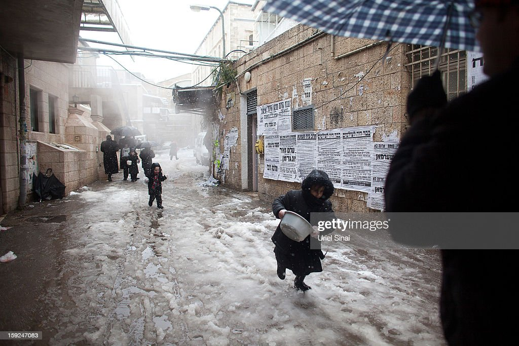 Ultra-orthodox Jews enjoy the snow in the Mea Shearim religious neighborhood on January 10, 2013 in Jerusalem, Israel.