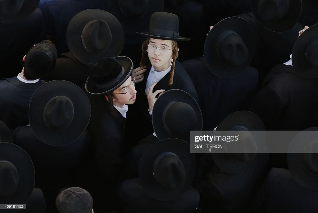 UltraOrthodox Jews mourn at the site of attack by two Palestinians on Jewish worshippers killing four Israelis at a synagogue in the UltraOrthodox...