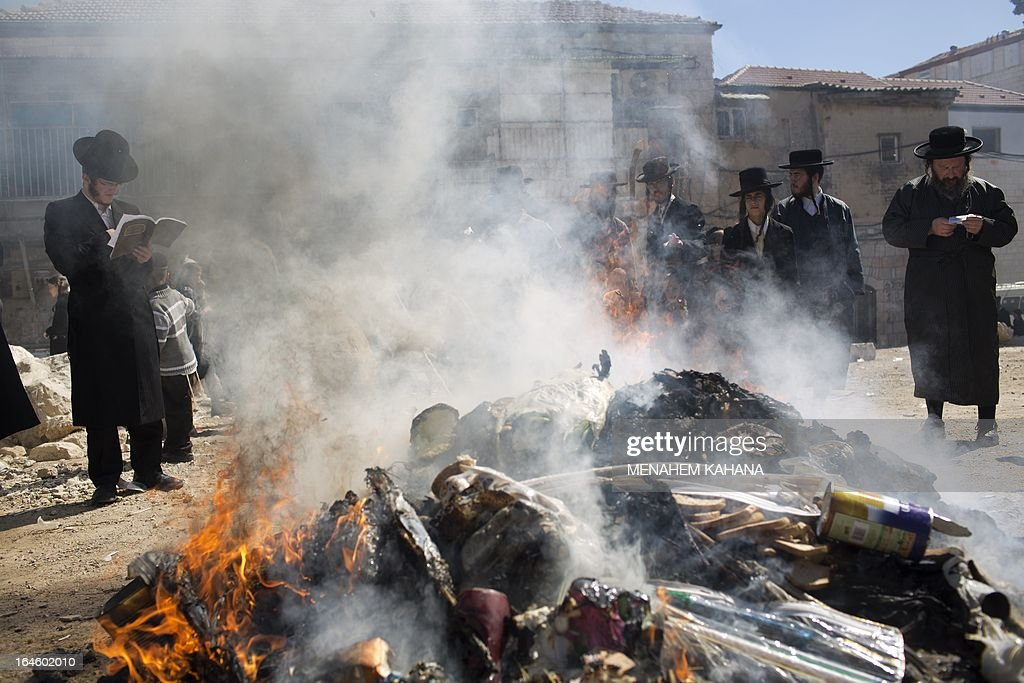 Ultra-Orthodox Jews pray as they burn leavened items in a final preparation before the start at sundown of the Jewish Pesach (Passover) holiday, on March 25, 2013 in Jerusalem. Religious Jews worldwide eat matzoth during the eight-day Pesach holiday that commemorates the Israelis' exodus from Egypt some 3,500 years ago and their ancestors' plight by refraining from eating leavened food products.