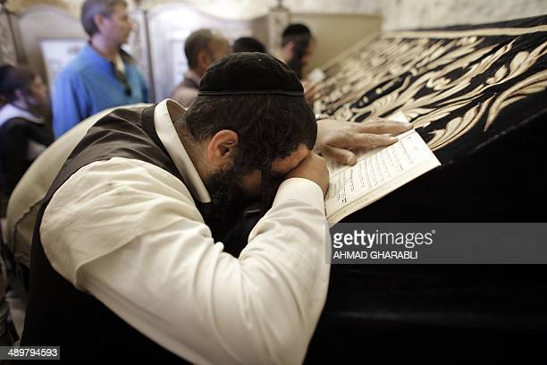 UltraOrthodox Jews pray inside the King David's tomb in the Old City of Jerusalem on May 12 2014 Hundreds of Orthodox Jewish protesters gathered...