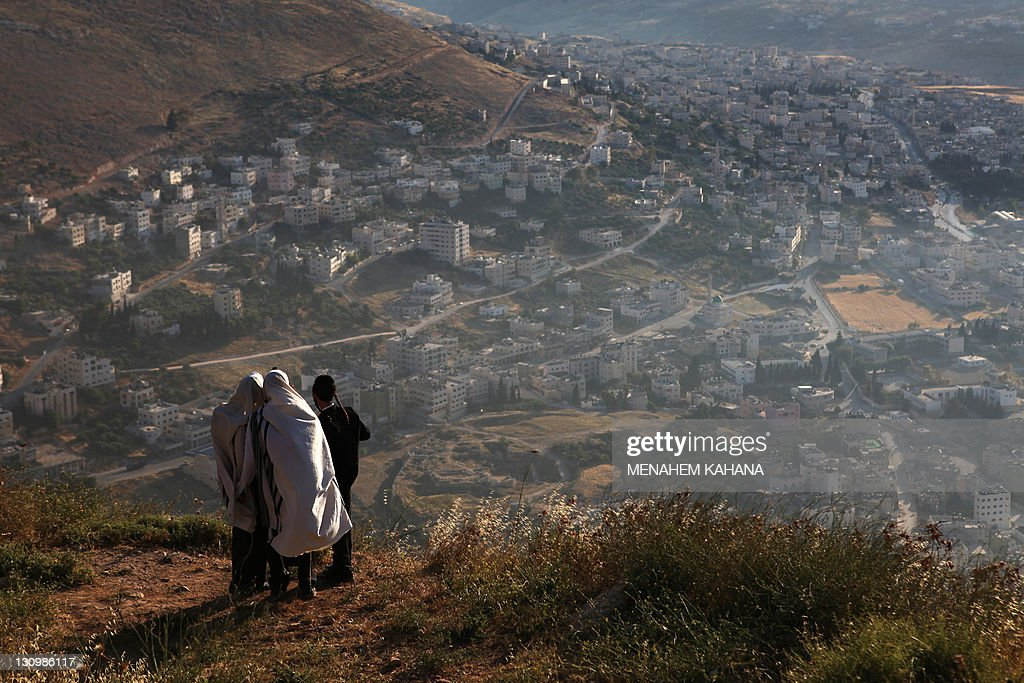 UltraOrthodox Jews pray on Mount Gerizim overlooking Joseph's Tomb one of their holiest sites in the West Bank city of Nablus on May 28 2009 The men...