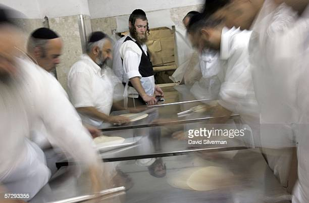 UltraOrthodox Jews race against the clock to roll out dough to prepare matza April 9 2006 in the Mea Shearim religious neighborhood of Jerusalem...