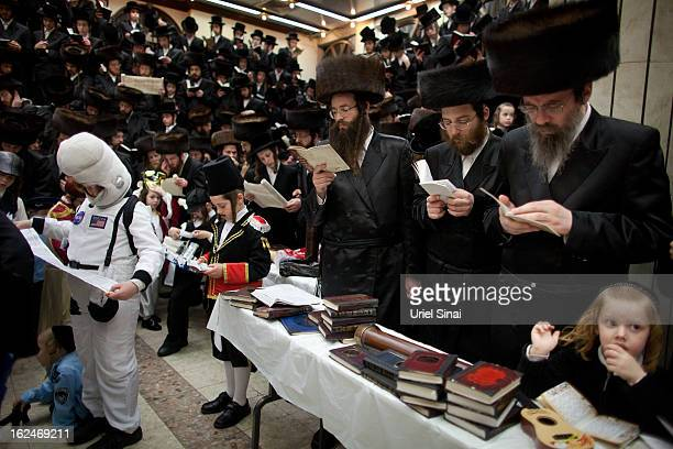 UltraOrthodox Jews read the Esther scrolls at a synagogue on February 23 2013 in Bnei Brak IsraelThe carnivallike Purim holiday is celebrated with...
