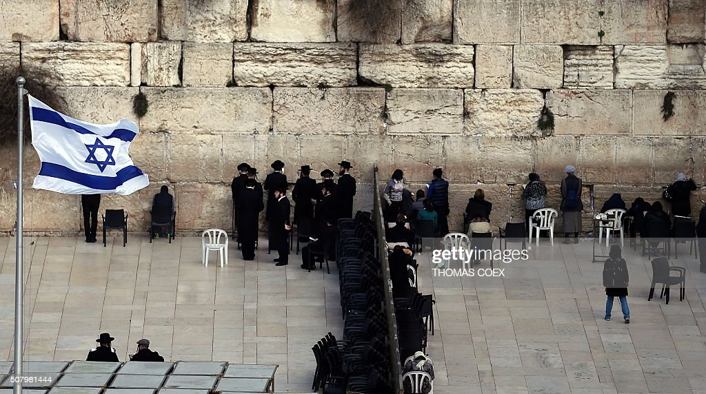 UltraOrthodox Jewsih men and women pray in two different sections at the Western Wall the most holy site where Jews can pray in Jerusalem's Old City...