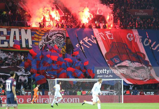Ultras fans of PSG 'Collectif Ultras Paris' aka CUP celebrate their 10th anniversary with smoke during the French Ligue 1 match between Paris...