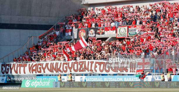 Ultras of DVTK sing the anthem of the club during the Hungarian OTP Bank Liga match between MTK Budapest and DVTK at Nandor Hidegkuti Stadium on May...