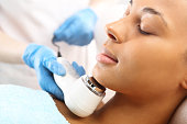 The woman's face during a facial at a beauty salon