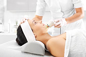 Light skin treatment, the woman in the beauty salon