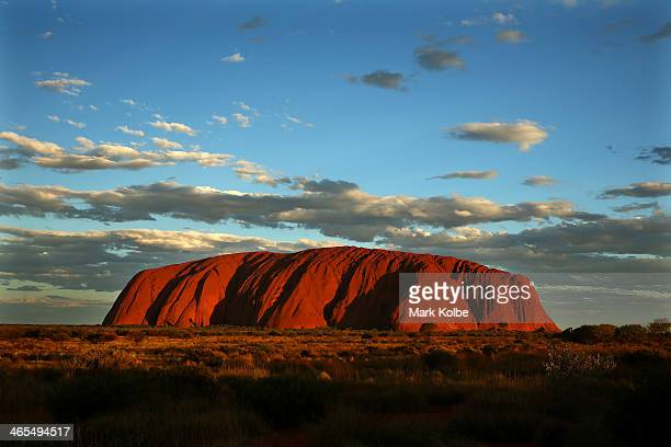 Uluru is seen at as the sun sets on November 27 2013 in UluruKata Tjuta National Park Australia Uluru/ Ayers Rock is a large sandstone formation...