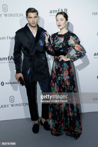 Ulyana Sergeenko and guest attend the amfAR Paris Dinner 2017 at Le Petit Palais on July 2 2017 in Paris France