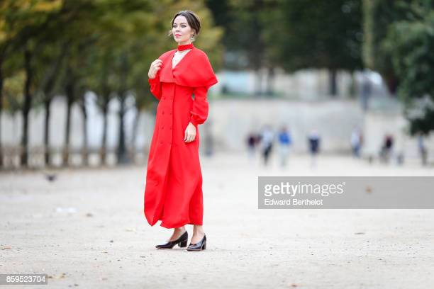 Ulyana Sergeenko is seen wearing a red dress at the Tuileries garden on October 7 2017 in Paris France