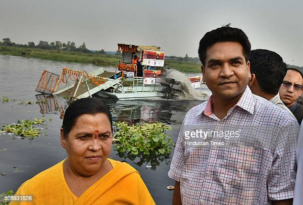 Uma Bharti Water Resources Minister along with Kapil Mishra during the launch of schemes under Yamuna Action PlanIII and flags off the first Trash...