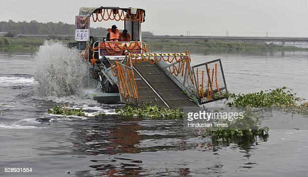Uma Bharti Water Resources Minister flags off the first Trash Skimmer for river surface cleaning on River Yamuna Namami Gange Project during the...