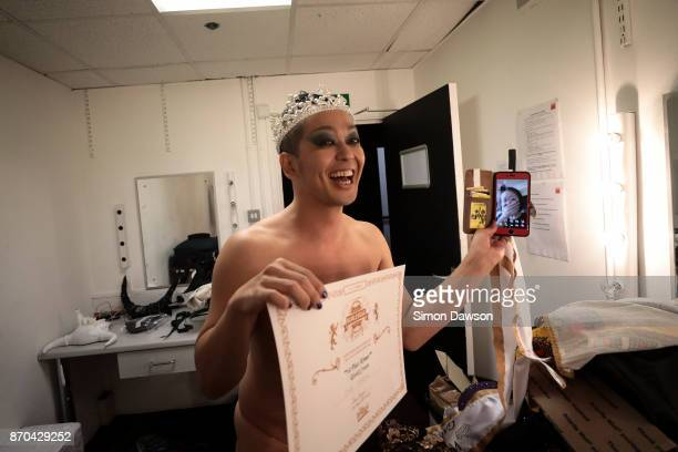 Uma Shadow of Japan reacts as he speaks to his wife on video chat after winning the World Crown at the World Burlesque Games 2017 on November 4 2017...