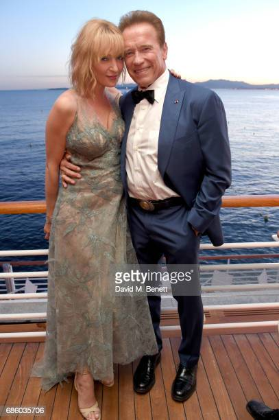 Uma Thurman and Arnold Schwarzenegger attend the Vanity Fair and HBO Dinner celebrating the Cannes Film Festival at Hotel du CapEdenRoc on May 20...