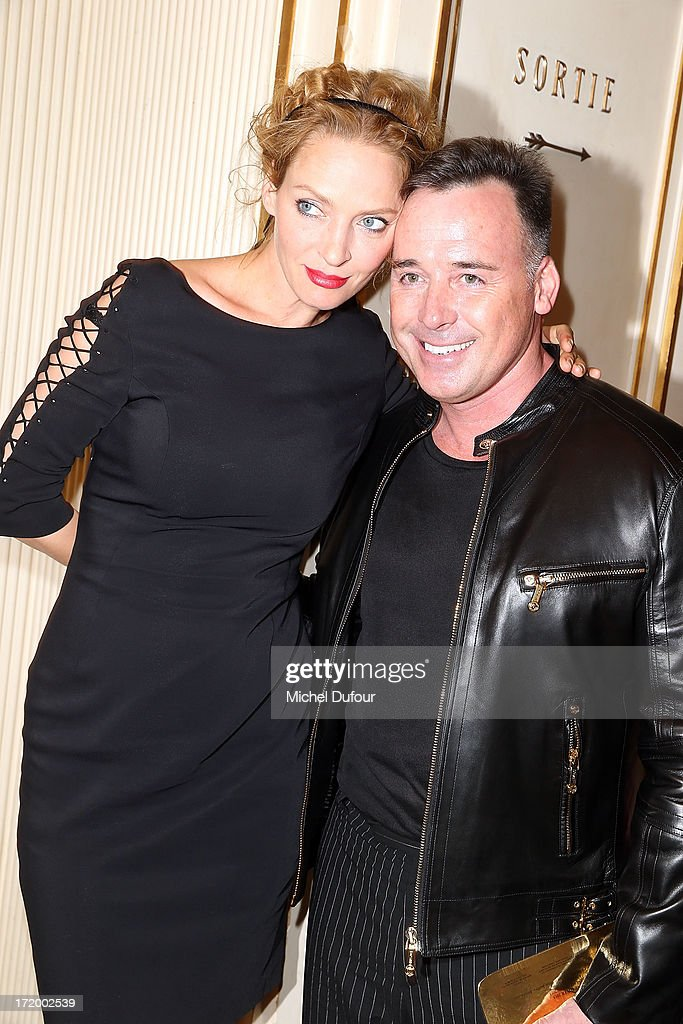 Uma Thurman and David Furnish attend the Versace show as part of Paris Fashion Week Haute-Couture Fall/Winter 2013-2014 at on June 30, 2013 in Paris, France.