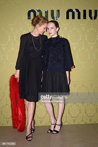Uma Thurman and her daughter Maya Hawke attend the Miu Miu Resort Collection 2015 at Palais d'Iena on July 5 2014 in Paris France