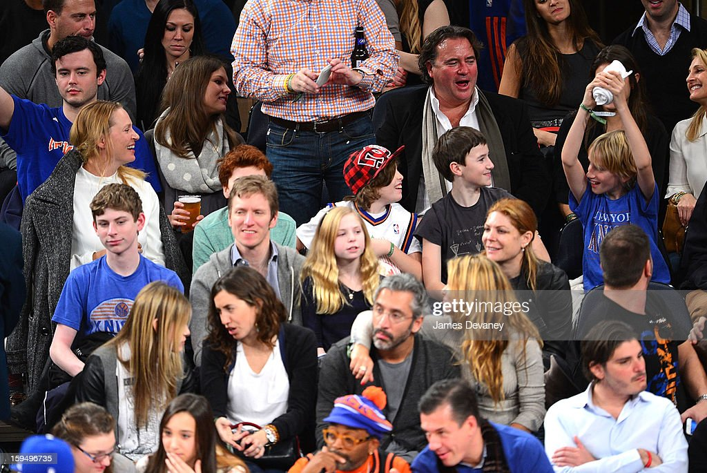 Uma Thurman (L) and Levon Roan Thurman-Hawke (R) attend the New Orleans Hornets vs New York Knicks game at Madison Square Garden on January 13, 2013 in New York City.