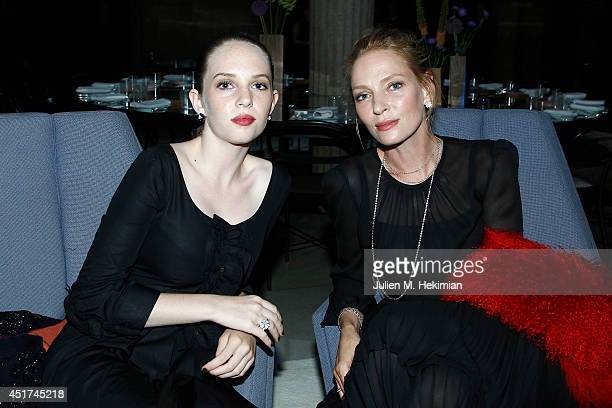 Uma Thurman and Maya Hawke attend the Miu Miu Resort Collection 2015 at Palais d'Iena on July 5 2014 in Paris France