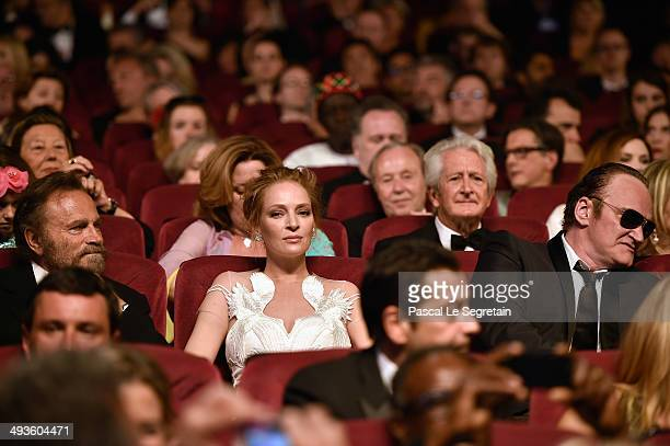 Uma Thurman and Quentin Tarantino sit in the audience during the Closing Ceremony at the 67th Annual Cannes Film Festival on May 24 2014 in Cannes...