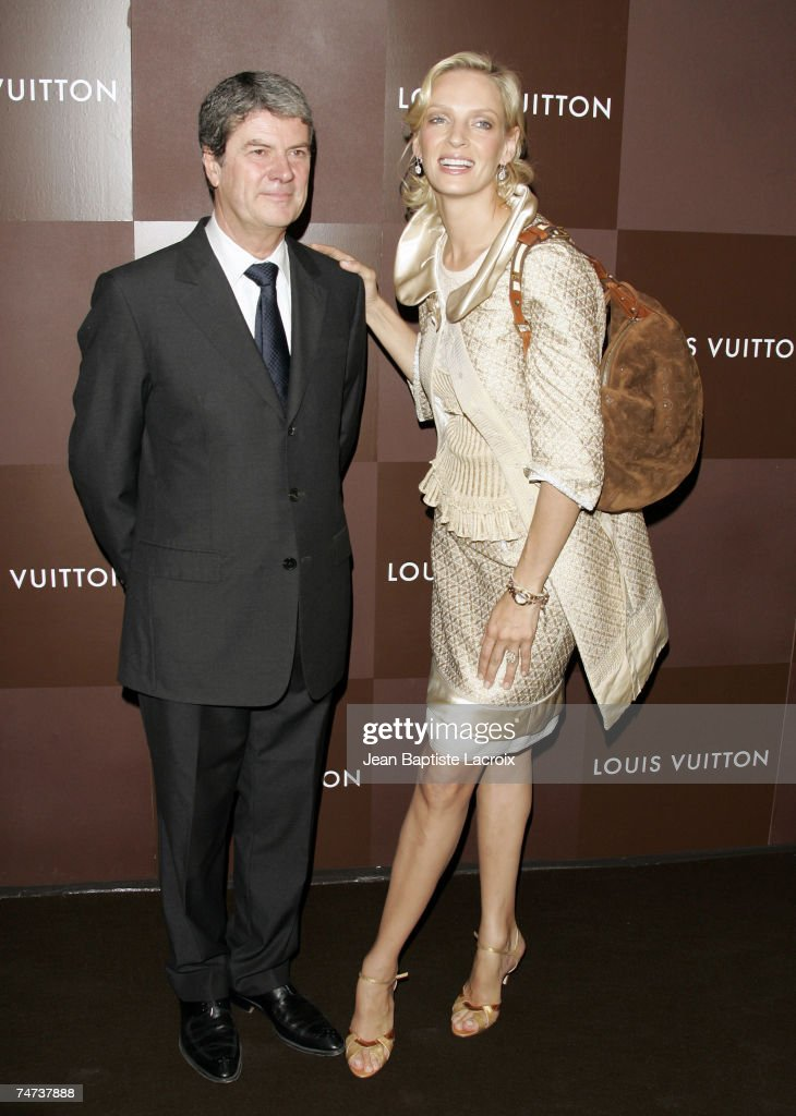 Uma Thurman and Yves Carcelle at the Louis Vuitton Store ChampsElyses in Paris France