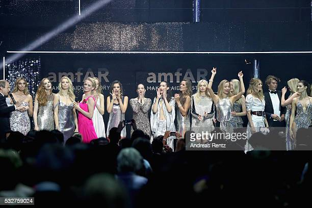 Uma Thurman ansd models appear on stage at the amfAR's 23rd Cinema Against AIDS Gala at Hotel du CapEdenRoc on May 19 2016 in Cap d'Antibes France