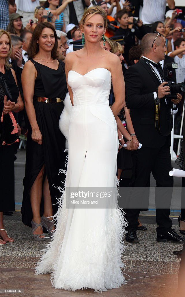 <a gi-track='captionPersonalityLinkClicked' href=/galleries/search?phrase=Uma+Thurman&family=editorial&specificpeople=171973 ng-click='$event.stopPropagation()'>Uma Thurman</a> arrives at the Midnight In Paris' Premiere part of the 64th Cannes Film Festival at Palais des Festivals on May 11, 2011 in Cannes, France.