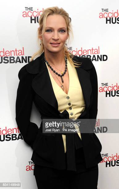 Uma Thurman arrives with firemen for the UK premiere of The Accidental Husband at the Vue Cinema in Leicester Square London