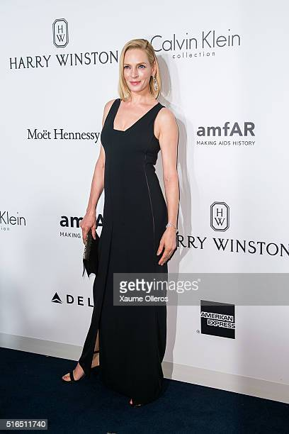 Uma Thurman attends the 2016 amfAR Hong Kong gala with a guest at Shaw Studios on March 19 2016 in Hong Kong Hong Kong