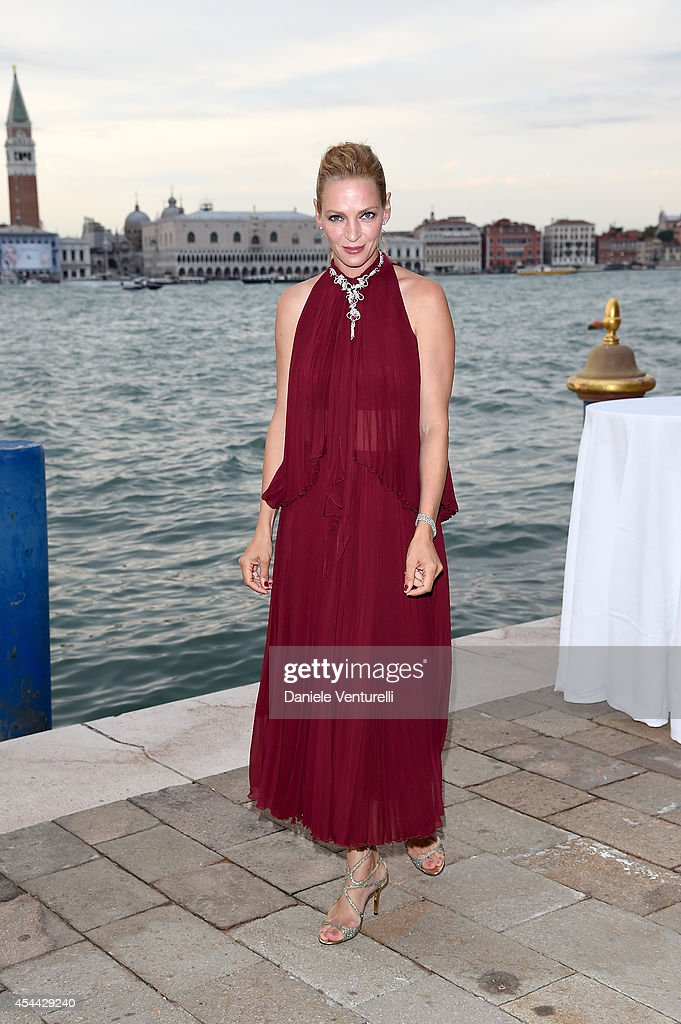 Uma Thurman attends the Chopard And Vanity Fair Present 'Backstage At Cinecitta' Exhibition Red Carpet 71st Venice Film Festival at Cipriani Hotel on...