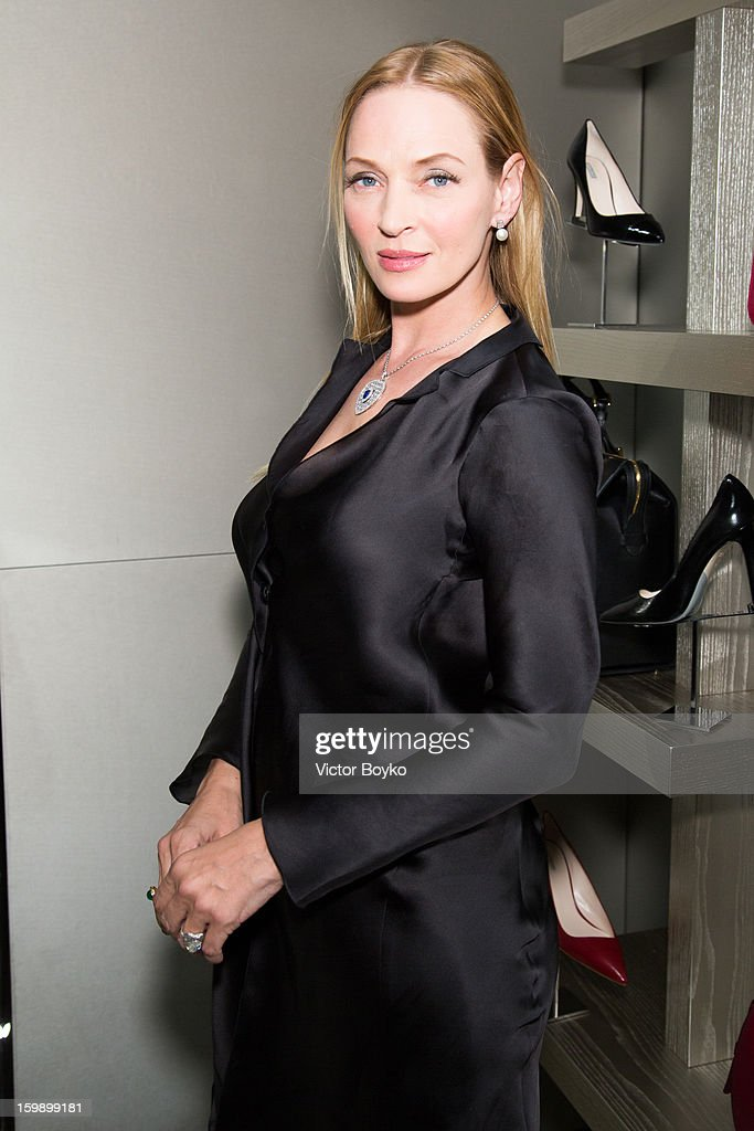 <a gi-track='captionPersonalityLinkClicked' href=/galleries/search?phrase=Uma+Thurman&family=editorial&specificpeople=171973 ng-click='$event.stopPropagation()'>Uma Thurman</a> attends the Giorgio Armani Paris avenue Montaigne boutique opening on January 22, 2013 in Paris, France.