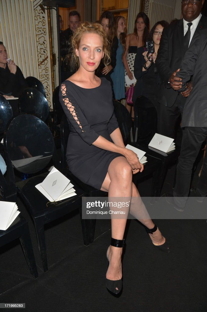 <a gi-track='captionPersonalityLinkClicked' href=/galleries/search?phrase=Uma+Thurman&family=editorial&specificpeople=171973 ng-click='$event.stopPropagation()'>Uma Thurman</a> attends the Versace show as part of Paris Fashion Week Haute-Couture Fall/Winter 2013-2014 at on June 30, 2013 in Paris, France.