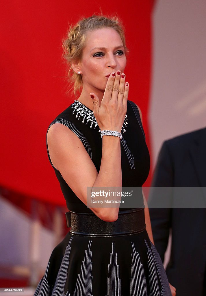 <a gi-track='captionPersonalityLinkClicked' href=/galleries/search?phrase=Uma+Thurman&family=editorial&specificpeople=171973 ng-click='$event.stopPropagation()'>Uma Thurman</a> blows a kiss to the crowd at the 'Nymphomaniac: Volume 2 - Directors Cut' Premiere during the 71st Venice Film Festival on September 1, 2014 in Venice, Italy