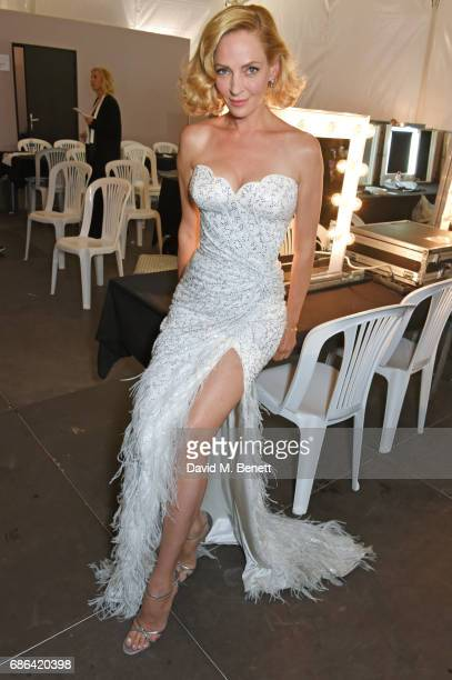 Uma Thurman poses backstage at the Fashion for Relief event during the 70th annual Cannes Film Festival at Aeroport Cannes Mandelieu on May 21 2017...