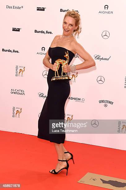 Uma Thurman poses with her award during Kryolan at the Bambi Awards 2014 on November 13 2014 in Berlin Germany