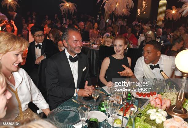Uma Thurman Remo Ruffini Jessica Chastain and Will Smith attend the amfAR Gala Cannes 2017 at Hotel du CapEdenRoc on May 25 2017 in Cap d'Antibes...