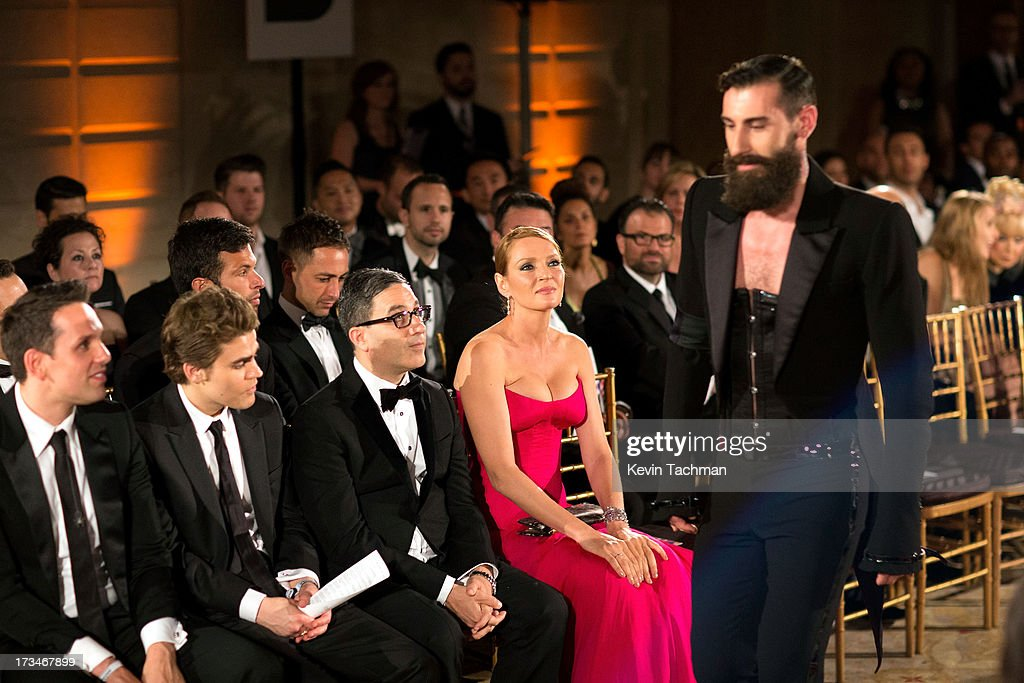 <a gi-track='captionPersonalityLinkClicked' href=/galleries/search?phrase=Uma+Thurman&family=editorial&specificpeople=171973 ng-click='$event.stopPropagation()'>Uma Thurman</a> watches the runway during the 4th Annual amfAR Inspiration Gala New York at The Plaza Hotel on June 13, 2013 in New York City.