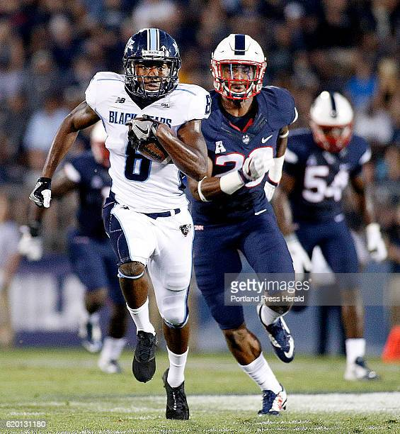 UMaine's Jaleel Reed breaks away from UConn defender Obi Melifonwu for a large first half gain during a NCAA Division I football game at Rentschler...