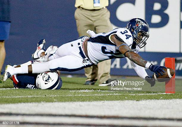 UMaine's Josh Mack extends the ball over the pylon and into the endzone for a first half touchdown over Obi Melifonwu of UConn to put Maine up 70...