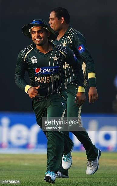Umar Akmal and Zulfiqar Babar of Pakistan celebrates the wicket of Glenn Maxwell of Australia during the first match of the one day international...