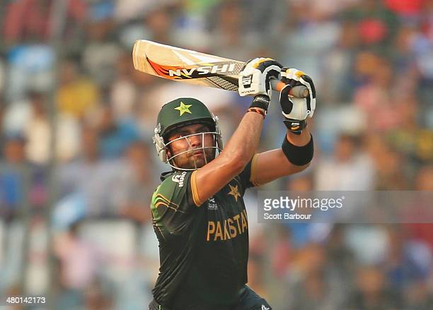 Umar Akmal of Pakistan bats during the ICC World Twenty20 Bangladesh 2014 match between Australia and Pakistan at ShereBangla Mirpur Stadium on March...