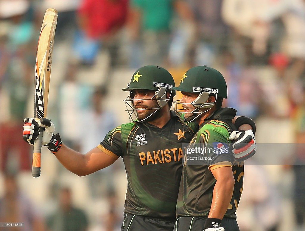 <a gi-track='captionPersonalityLinkClicked' href=/galleries/search?phrase=Umar+Akmal&family=editorial&specificpeople=4880796 ng-click='$event.stopPropagation()'>Umar Akmal</a> of Pakistan celebrates after reaching his fifty with <a gi-track='captionPersonalityLinkClicked' href=/galleries/search?phrase=Kamran+Akmal&family=editorial&specificpeople=221679 ng-click='$event.stopPropagation()'>Kamran Akmal</a> during the ICC World Twenty20 Bangladesh 2014 match between Australia and Pakistan at Sher-e-Bangla Mirpur Stadium on March 23, 2014 in Dhaka, Bangladesh.