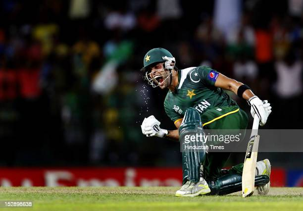 Umar Akmal of Pakistan celebrates victory over South Africa after the ICC T20 World Cup Super Eight group 2 cricket match between Pakistan and South...